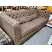 Brown Sofa With Three Throw Pillows