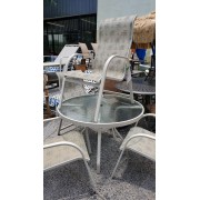 Tan Patio Table With Four Chairs